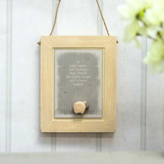'A Baby Makes Love Stronger' Hanging Nursery Picture